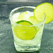 Rum Cocktail with limes - Stock Photo