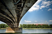 Old bridge in Warsaw with National Stadium construction. — Stock Photo