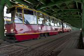 Red tram in Warsaw on old bridge — Stock Photo
