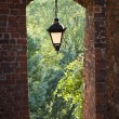 Hanging lamp in the gate of Sandomierz — Stock Photo