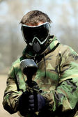 Paintball Player with marker — Stock Photo