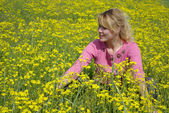 Girl on spring meadow — Stock Photo