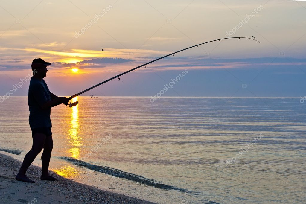 The siluette of single fisherman — Stock Photo #5989453