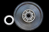 Gear wheels on black surface — Stok fotoğraf