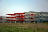 Wind turbines wings lying on field. — Stock Photo