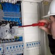 electrician during measurment — Stock Photo
