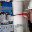 Electrician during measurment - Stock Photo