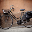 Old retro bicycle with basket in Italy — Stock Photo #5745572