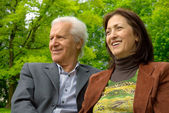Middle-aged happy couple in a park — Stock Photo