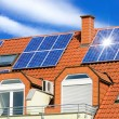 Stock Photo: Solar panel on a red roof