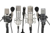 Row of seven microphones — Stock Photo