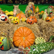 Cute arrangement of painted pumpkins — Stock Photo