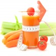 Glass of vegetable juice with tape measure — Stock Photo