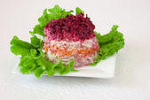 Russian vegetable salad with herring — Stock Photo