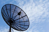 Satellite dish and blue sky — Stock Photo