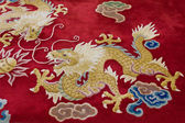 Dragon image on the carpet — Stock Photo