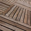 Patterns and textures of a wooden planks pavement — Foto Stock