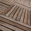 Patterns and textures of a wooden planks pavement — Stockfoto