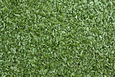Background texture with fake grass in a public children playgrou — Stock Photo