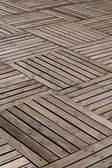 Patterns and textures of a wooden planks pavement — Stock Photo