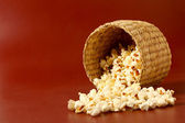 Popcorn on red background — Foto Stock