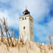 :Deserted lighthouse in the desert by the sea — Foto de Stock
