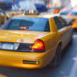 Motion and lens blurred taxi or cap, Manhatten, New York - ストック写真