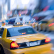 Motion and lens blurred taxi or cap, Manhatten, New York - Stock Photo