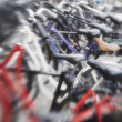 A lens blurred photo of lots of parked bikes. Symbolic content. — ストック写真