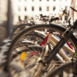 A lens blurred image of bikes - Stock Photo