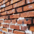 A photo of a very old brick wall — Foto Stock