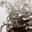 A lens blurred photo of lots of parked bikes - Stock fotografie