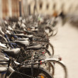 A lens blurred photo of lots of parked bikes - Stock Photo