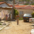 Editorial photo: Poor South African township - Stock Photo