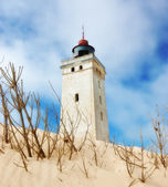 :Deserted lighthouse in the desert by the sea — Stock Photo