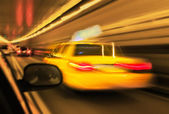 Motion and lens blurred taxi or cap — Стоковое фото