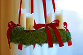 A photo of Advent wreath with big white candles — Stock Photo