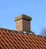 A photo of a typical chimney on a private house — Stock Photo