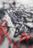 A lens blurred photo of lots of parked bikes. Symbolic content. — Stock Photo