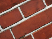 A close-up photo of a wall of red bricks — Stock Photo
