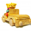 Toy overs driving their wooden car - Stock Photo