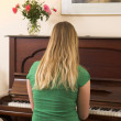 Young woman playing piano — Stock Photo