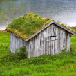 A photo of a farm cottage north of the Polar Circle in Norway - Stock Photo
