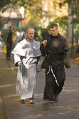 Young monks in the streets of Krakow — Stock Photo