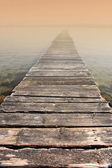 Photo of small bridge entering the morning mist — Stock Photo