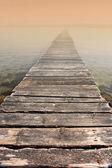 Photo of small bridge entering the morning mist — Stock Photo