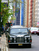 Photo of a luxury car parked in front of Central Park, New York — Stock Photo