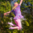 Happy girl jumping — Stock Photo