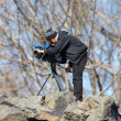 Stock Photo: Editorial: TV-News film maker in Central Park, New York