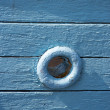 Window in an old sailing boat - Stock Photo